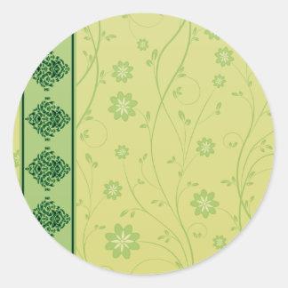 Inspiring greenish blossom on yellow texture round stickers