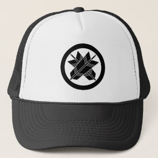 Intersecting arrows in circle trucker hat