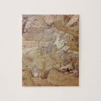 Interweaving particle board jigsaw puzzle
