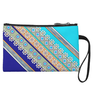 Intricate floral designed wristlet in blues/aqua