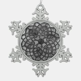 Intricate metalwork grey mandala style decoration