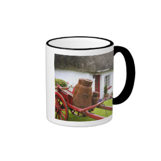 Ireland, Adare. Metal containers on cart and Ringer Mug