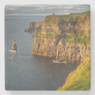 Ireland coastline at sunset stone coaster
