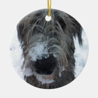 irish wolfhound playing in the snow round ceramic decoration