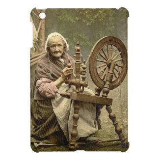 Irish Woman and Spinning Wheel 1890 iPad Mini Covers