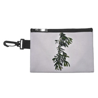 Isolated dark green branch against white backgroun accessory bag