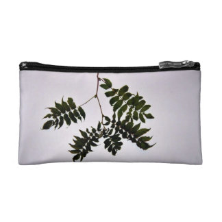 Isolated dark green leaves branch cosmetic bags