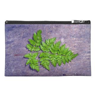 Isolated fresh fern leaf travel accessory bags