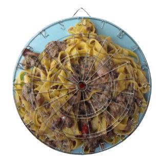 Italian fettuccine pasta with porcini mushrooms dartboard