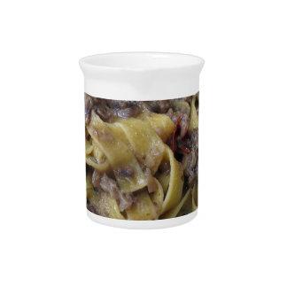 Italian fresh fettuccine or tagliatelle pasta pitcher