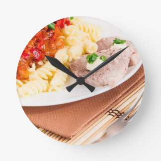 Italian pasta and slices of meat round clock