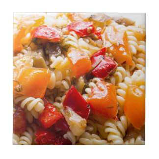 Italian pasta fusilli with vegetable ragout of pep small square tile