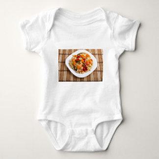 Italian pasta fusilli wooden background baby bodysuit