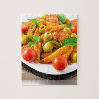 Italian pasta penne in tomato sauce with olives jigsaw puzzle