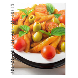 Italian pasta penne in tomato sauce with olives spiral notebook