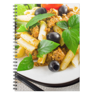 Italian pasta rigatoni with bolognese, beef spiral notebook