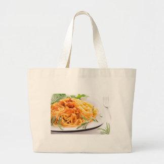Italian spaghetti with vegetable sauce closeup large tote bag