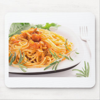 Italian spaghetti with vegetable sauce closeup mouse pad