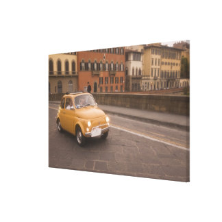 Italy, Florence. Fiat 800 Rally crosses Arno Stretched Canvas Print