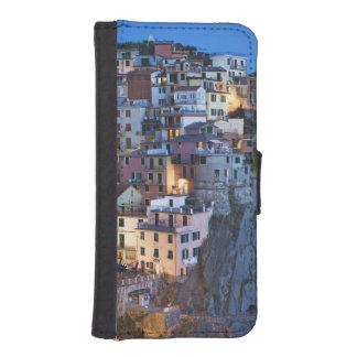 Italy, Manarola. Dusk falls on a hillside town