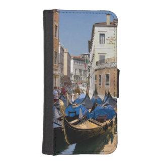 Italy, Venice, gondolas moored along canal