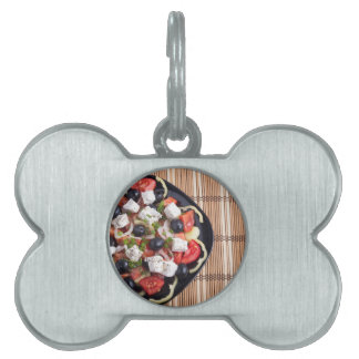 ITop view of a Greek salad with fresh vegetables Pet Name Tag