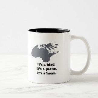 It's a bird. It's a plane. It's a Hoax Coffee Mugs