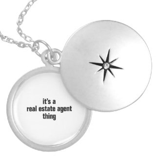 its a real estate agent thing round locket necklace