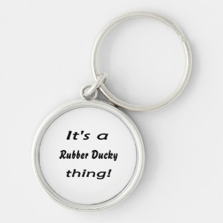 It's a rubber ducky thing! Silver-Colored round key ring