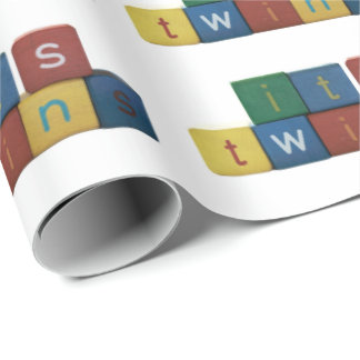 It's twins in children's block letters wrapping paper