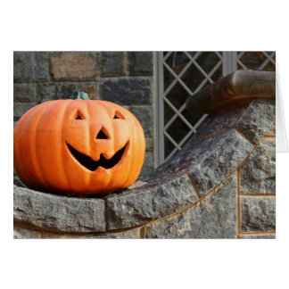 Jack-o-lantern on a stone wall greeting card