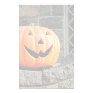 Jack-o-lantern on a stone wall stationery design