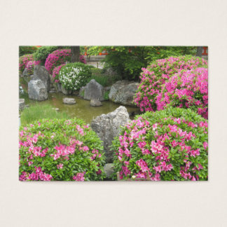 Japan stone garden with pink rhododendron flowers business card