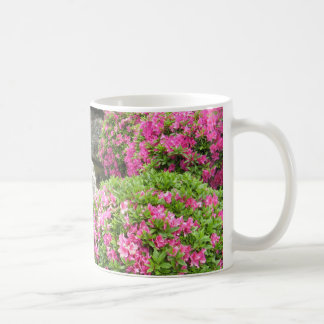 Japan stone garden with pink rhododendron flowers coffee mug