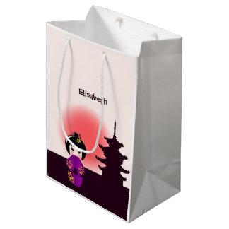 Japanese kokeshi doll at temple during sunset girl medium gift bag