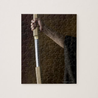 Japanese man holding sword 2 puzzles