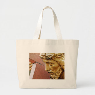 Jesus carrying the cross large tote bag