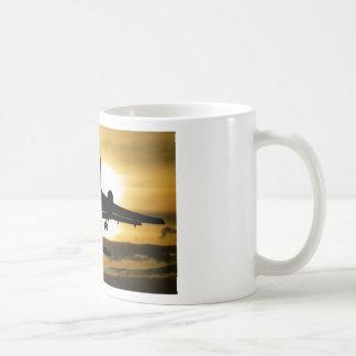 Jet Aircraft Against the Amber Sky Coffee Mug
