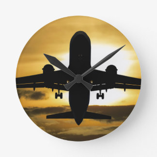 Jet Aircraft Against the Amber Sky Round Clock