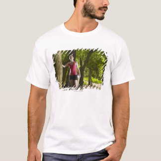 Jogger stretching in forest T-Shirt