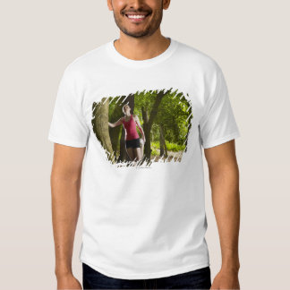 Jogger stretching in forest t-shirts