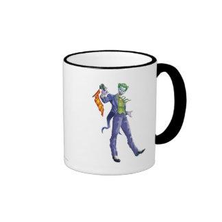Joker stands with gun ringer mug