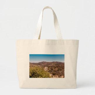 Joshua tree lonely desert road large tote bag