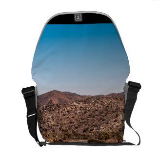 Joshua tree lonely desert road messenger bags