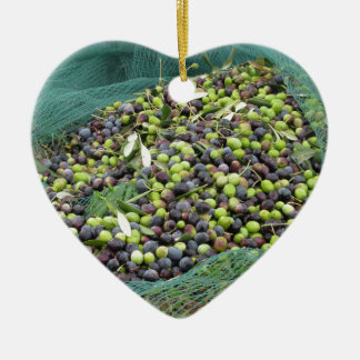 Just picked olives on the net during harvest time ceramic heart decoration