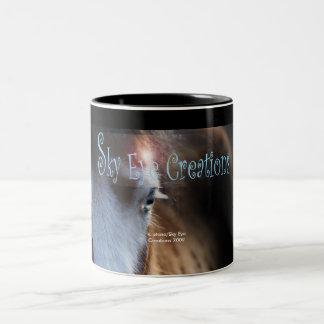 Keegan poses for Sky Eye Creations Two-Tone Mug