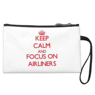 Keep calm and focus on AIRLINERS Wristlets
