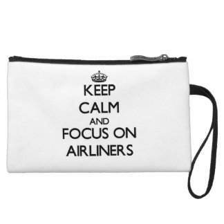 Keep Calm And Focus On Airliners Wristlet Clutch