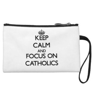 Keep Calm and focus on Catholics Wristlet Clutches
