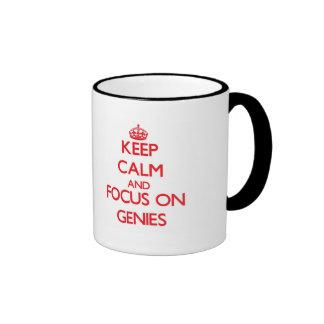 Keep Calm and focus on Genies Coffee Mugs